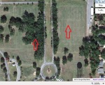 Mother and step-father's headstones are near the left red arrow and Father's headstone near the right red arrow.